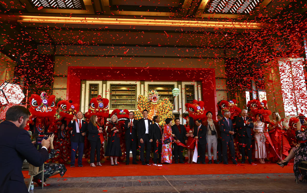 Confetti goes off as the ribbon is cut to mark the opening of Resorts World Las Vegas on Thursd ...